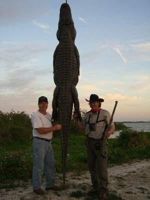 Two men and a trophy gator in Orlando, FL.